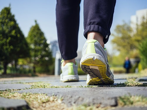 Woman Walking in Park Outdoor Jogging exercise Healthy Lifestyle